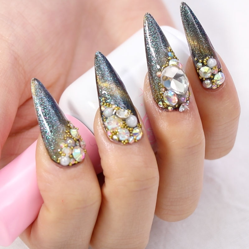 Cat Eye with Glassy Style Nail Art and Rhinestone Design Application